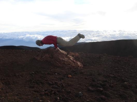 Andrey doing yoga at the summit of Mauna Kea